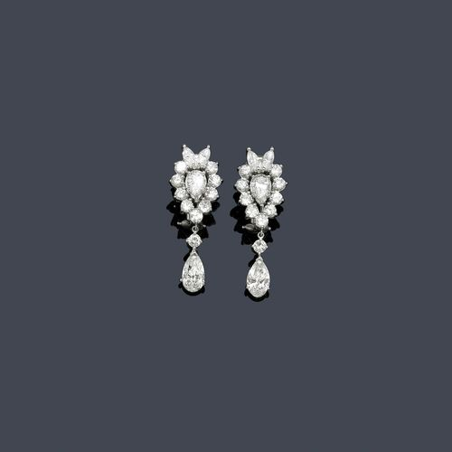 DIAMOND EAR PENDANTS, VAN CLEEF & ARPELS, ca. 1960. Platinum 900. Classic-elegant ear clips, each set with 1 drop-cut diamond within a border of 6 brilliant-cut diamonds and 2 navette-cut diamonds. The lower part, each with 1 flexibly mounted pendant with 1 drop-cut diamond and 1 brilliant-cut diamond. Total diamond weight ca. 4.60 ct. Signed V.C.A., No. NY 43003. Clip mechanism in white gold. L ca. 3.2 cm. Provenance: - Private collection - Sotheby's NY, Lot 26, April 2013.