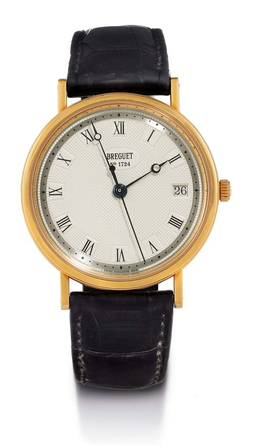 BREGUET, ELEGANT CLASSIC WRISTWATCH, ca. 2000. Yellow gold 750. Ref. 5917, flat, polished case No. 1724 K, fluted centre part, sapphire glass exhibition back, silver, engine-turned dial with black Roman numerals and blue Breguet hands, central second, date at 3h, dial signed: Breguet No. 1724. Flat automatic Cal. 591, movement No. 802311 with Geneva stripes and 25 rubies. Black, original crocodile band with gold clasp. D 35 mm.
