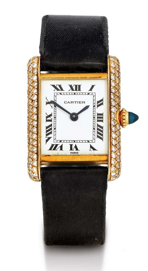 CARTIER TANK DIAMOND LADY'S WRISTWATCH, HAND WINDER, 1980s. Yellow gold 750. Ref. 933, rectangular case No. 780870054 J set throughout with diamonds, gold crown with sapphire cabochon. White dial with black Roman numerals and blued hands. Hand winding movement Cal. ETA 2512. Black satin band with gold Cartier fold-over clasp. D 28 x 21 mm.