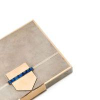 VAN CLEEF & ARPELS Minaudière en styptor et métal doré, stylisé d'une