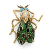 FABERGE Clip de corsage en or jaune et platine stylisé dun insecte, le