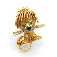 VAN CLEEF & ARPELS Clip de corsage en or jaune stylisé d'un lionceau,