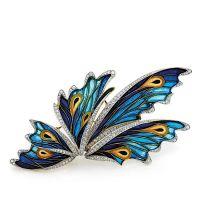 FABERGÉ Grand clip de corsage en or jaune et platine à décor d'ailes d