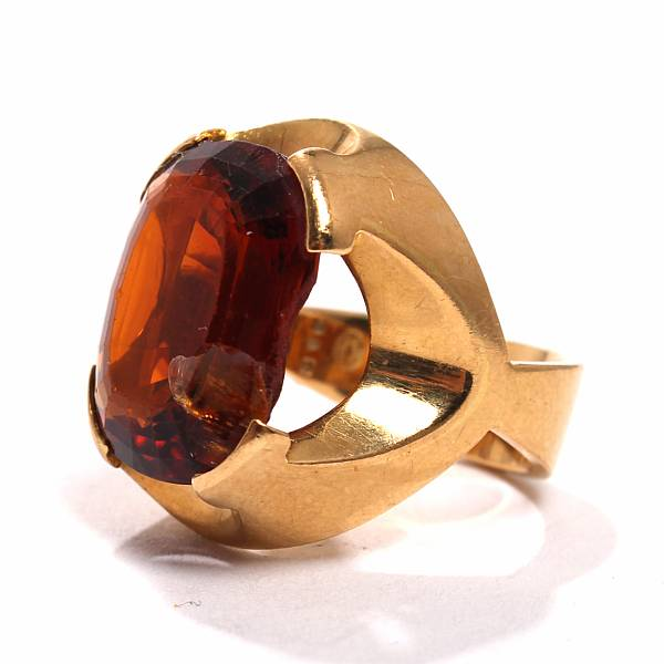Georg Jensen a.o.: Citrine ring set with a faceted citrine mounted in 18k gold. And tanzanite ring set with a faceted tanzanite mounted in 14k gold. (2)