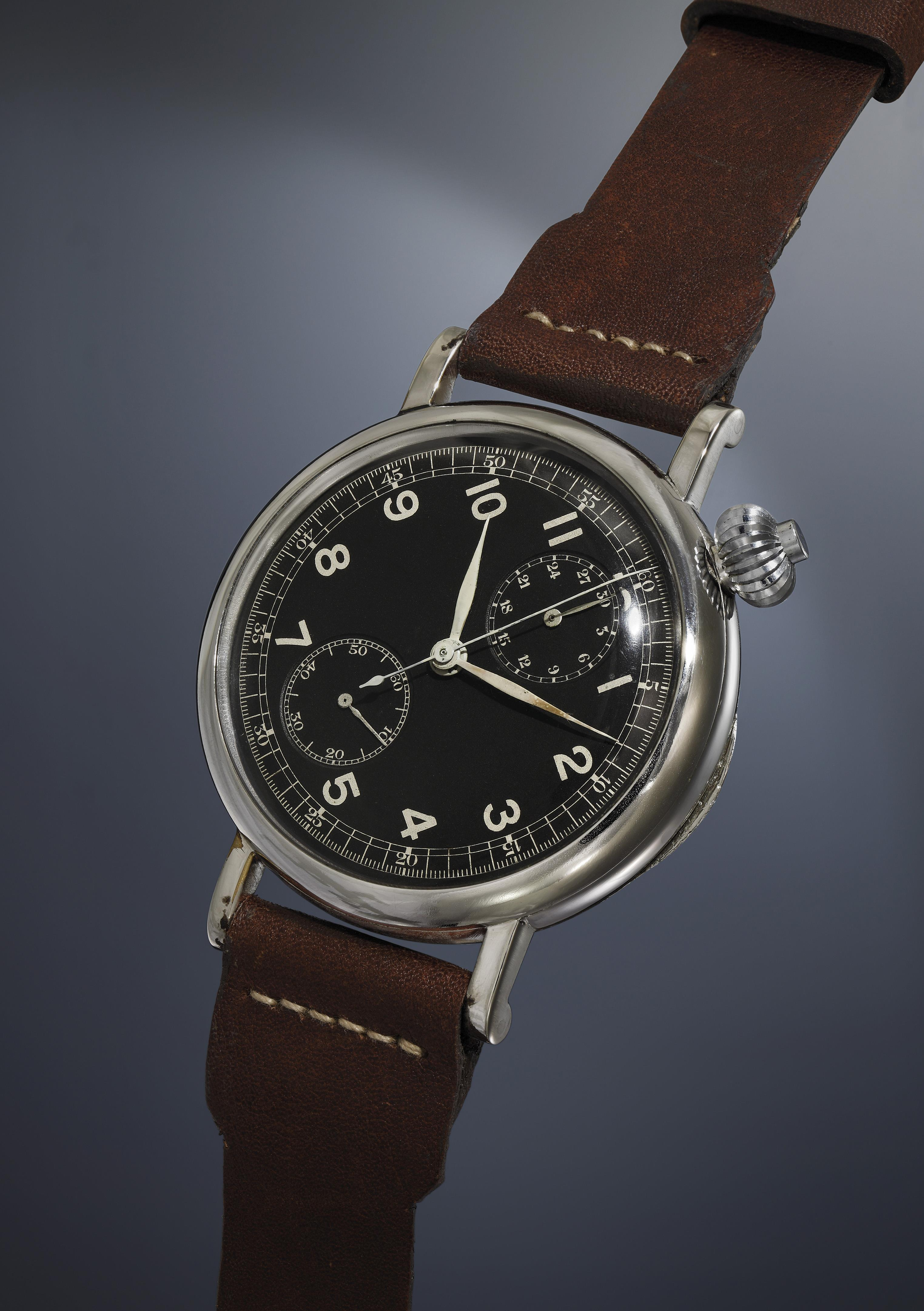 An oversized, rare and historically important asymmetrical chrome plated pilot's chronograph wristwatch with black dial, single button pusher and military markings, made for the US Army.