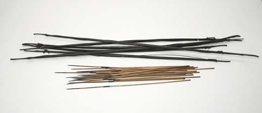Six Indonesian bows with arrows