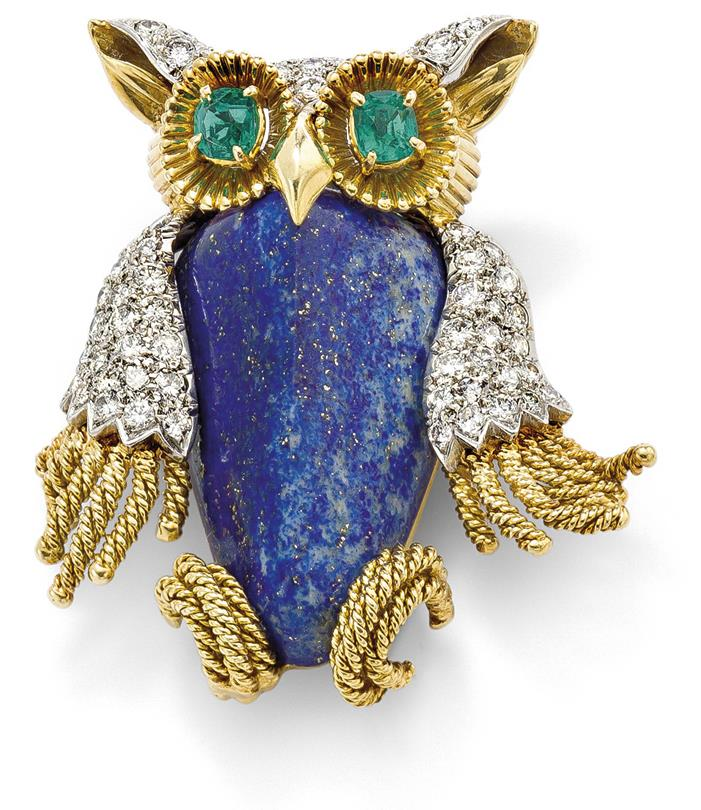 A lapis lazuli, diamond and emerald owl pin, by Van Cleef & Arpels