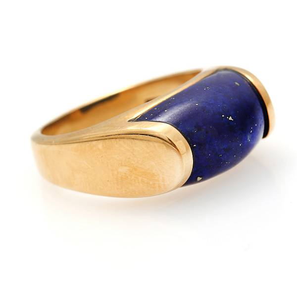 Bulgari: A lapis lazuli ring set with a polished lapis lazuli, mounted in 18k gold. Size 53.