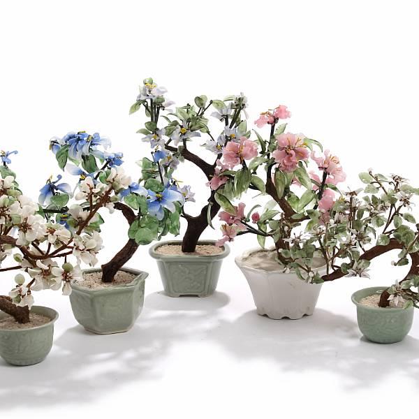 Five Oriental bonsai glass trees. 20th century. H. 25-37 cm. (5)