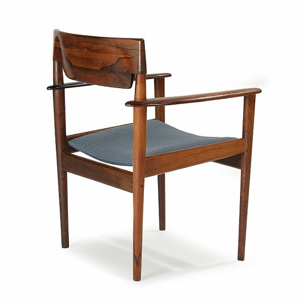 Grete Jalk: A Brazilian rosewood armchair, seat upholstered with blue patterned fabric. Manufactured by P. Jeppesen. 1960-1970's.