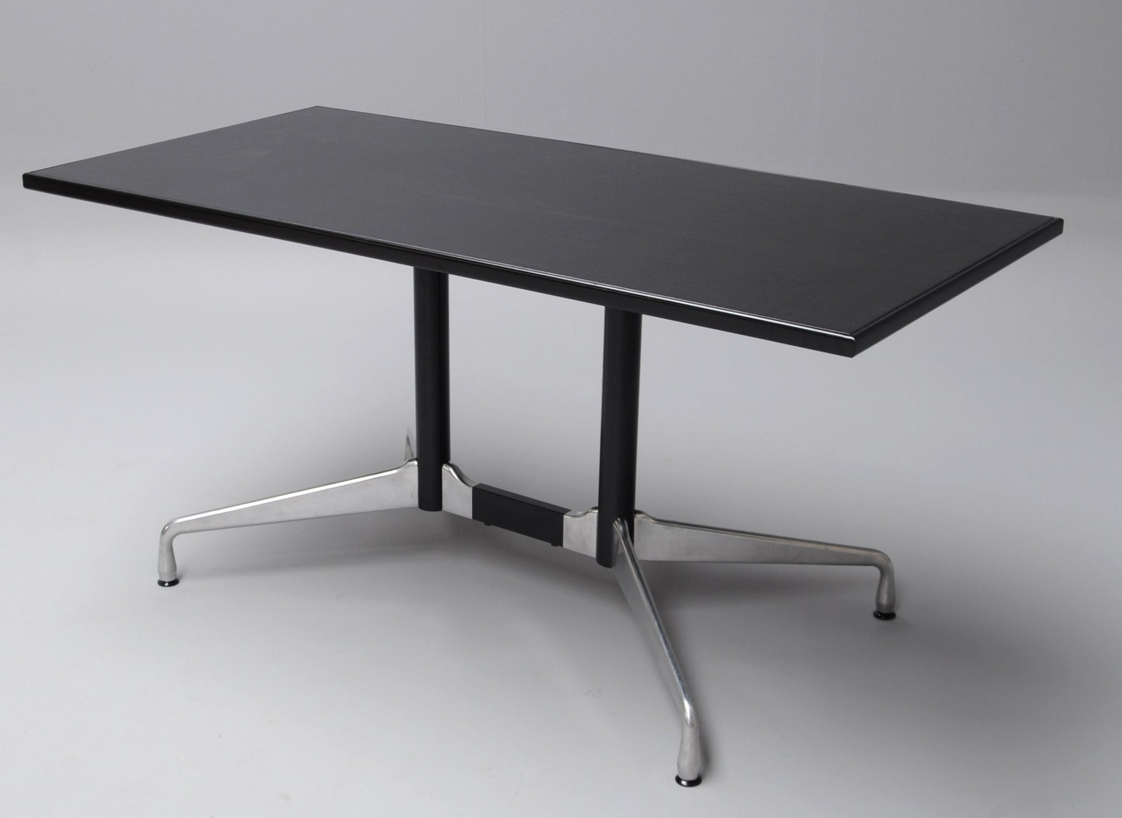 Charles & Ray Eames. Segmented Table covered with black leather