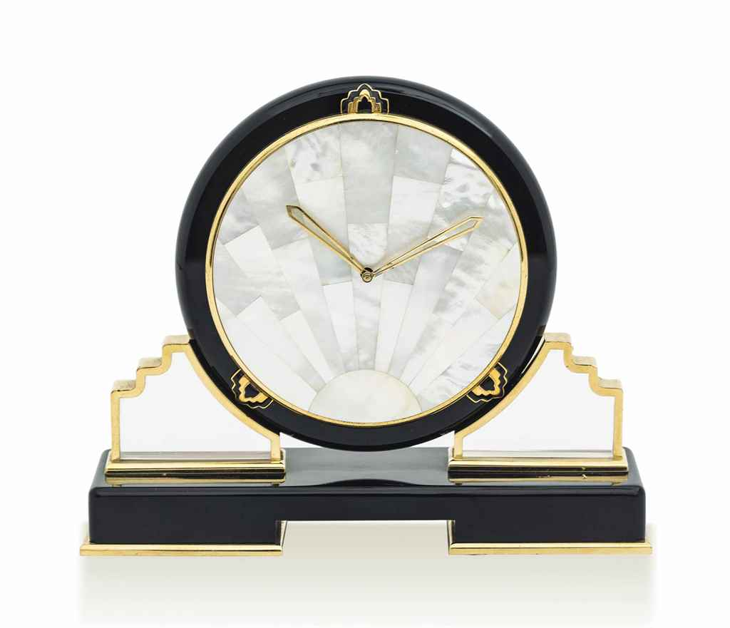 CARTIER. A VERY FINE ONYX AND MOTHER-OF-PEARL DESK CLOCK