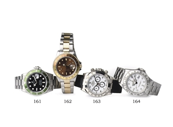 A STAINLESS STEEL AUTOMATIC WATER RESISTANT-WRISTWATCH WITH DUAL TIME CALENDAR, BY ROLEX