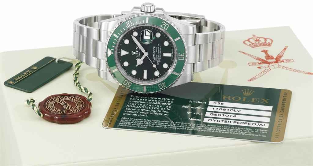 Rolex. A highly attractive, fine and rare stainless steel automatic wristwatch with date, green dial and bezel, original guarantee, sales tag and box, made for the Sultanate of Oman