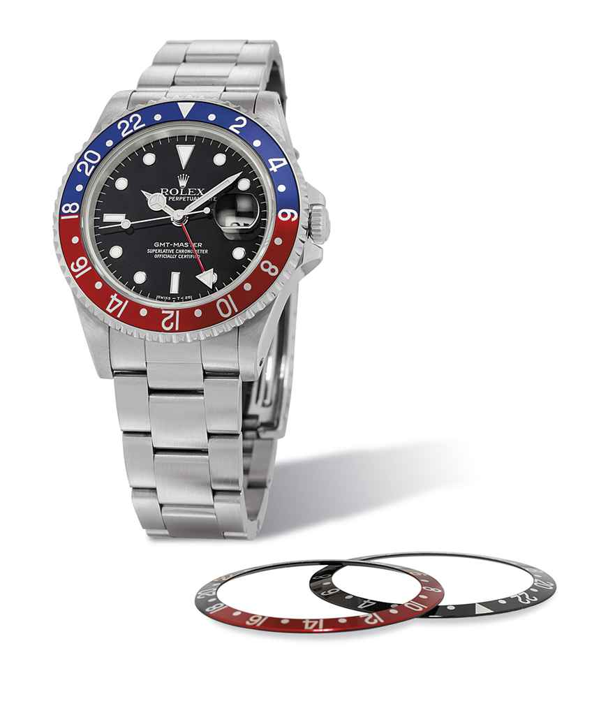 ROLEX. A STAINLESS STEEL DUAL TIME AUTOMATIC WRISTWATCH WITH DATE AND SWEEP CENTRE SECONDS