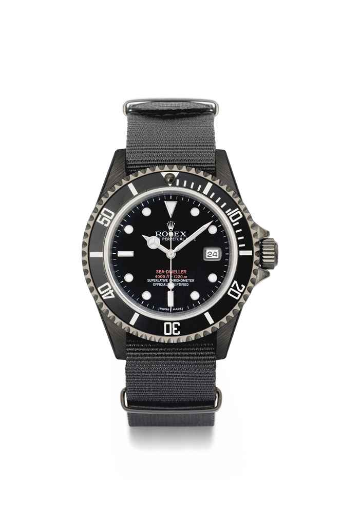 """Project X Designs. A very rare black DLC coated stainless steel limited edition automatic diver's wristwatch with gas escape valve, sweep centre seconds, date, hack feature, black dial with double red """"Sea-Dweller 4000ft=1220m"""" printing, limited edition certificate, original envelope, guarantees, sales tags and presentation box"""