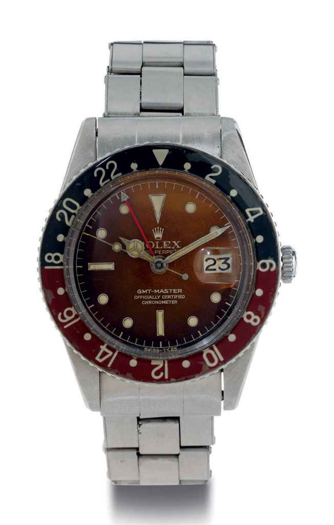 ROLEX. A RARE AND EARLY STAINLESS STEEL AUTOMATIC DUAL TIME WRISTWATCH WITH DATE, CENTER SECONDS AND BAKELITE BEZEL