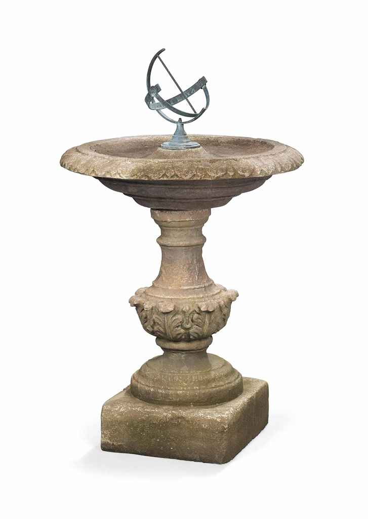 A COMPOSITE STONE BIRDBATH WITH EQUATORIAL DIAL