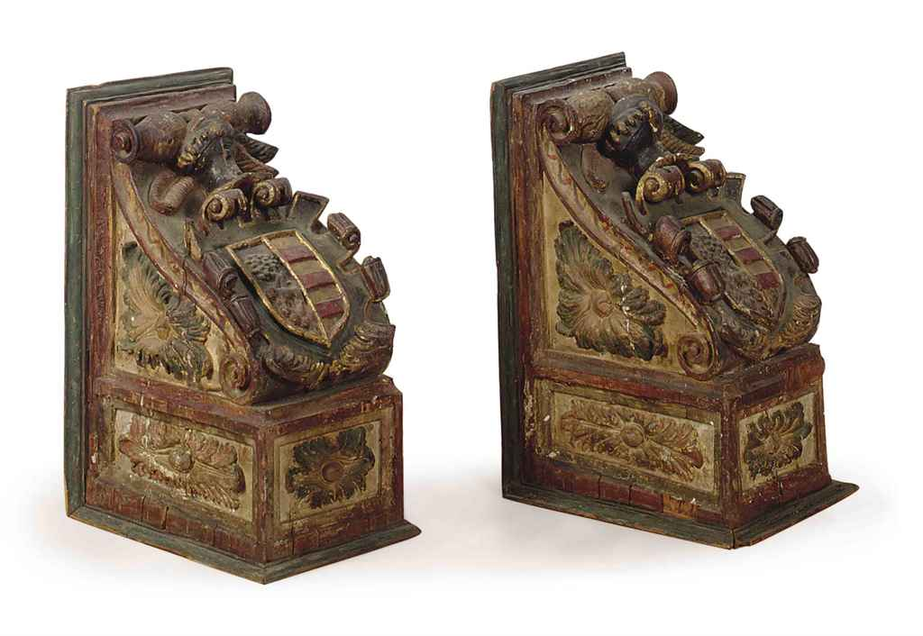 A PAIR OF CONTINENTAL POLYCHROME DECORATED CARVED PINE CORBELS,