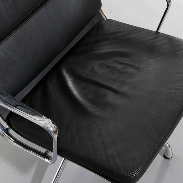 "Charles Eames, Ray Eames: ""Soft Pad Lounge chair"". Highback easy chair with frame of chromed aluminium. Manufactured by Vitra."