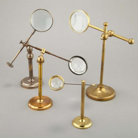 Group of Four Brass and Glass Adjustable Magnifying Glasses