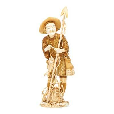 JAPANESE CARVED IVORY FIGURE; Man...