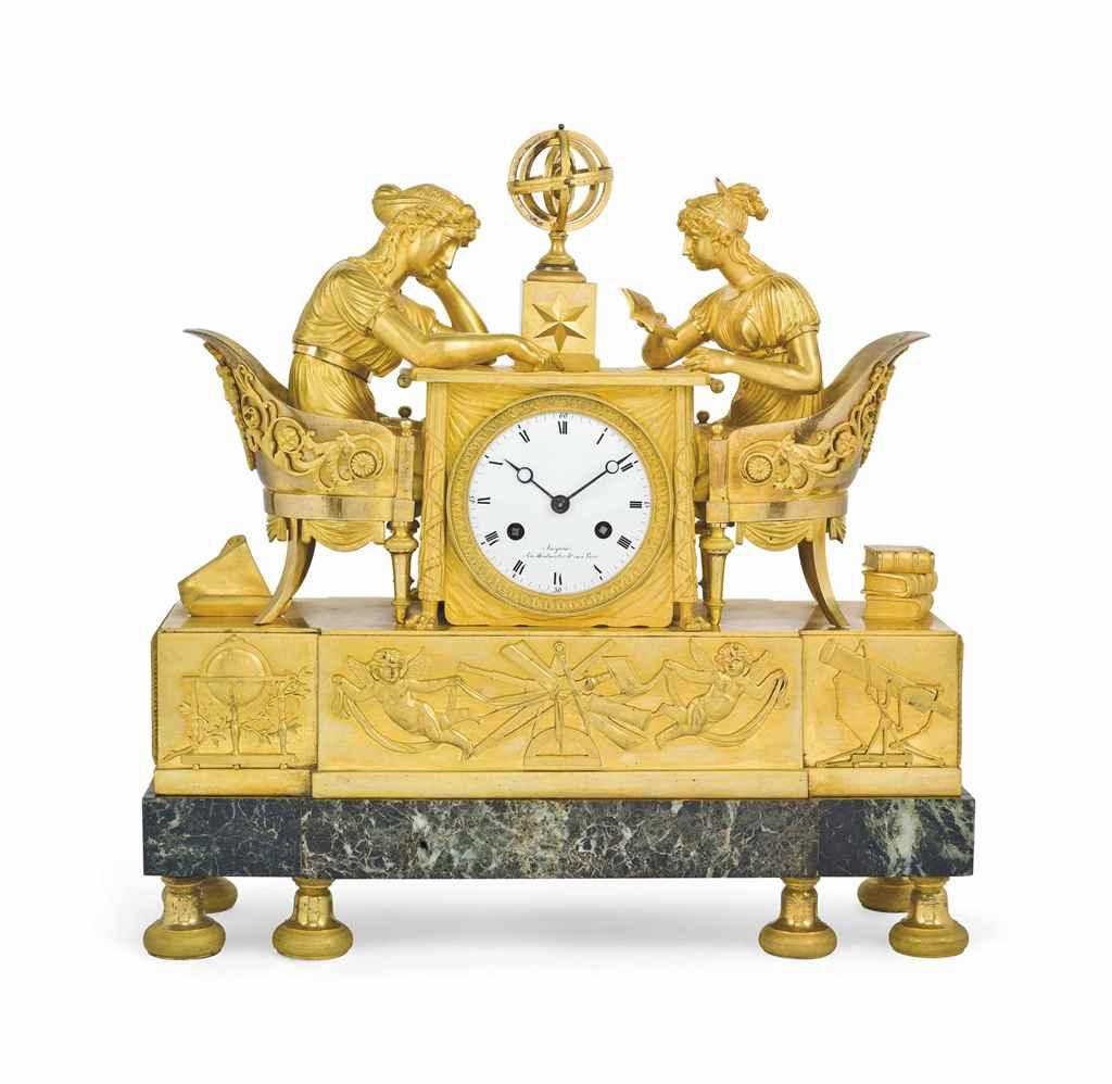 AN EMPIRE ORMOLU AND VERDE ANTICO MARBLE MANTEL CLOCK