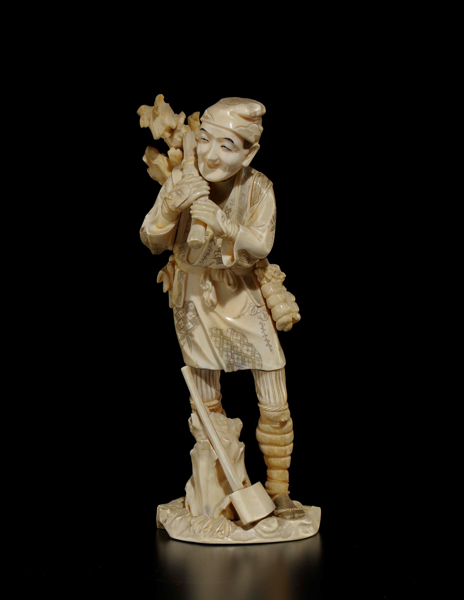 A carved ivoty figure of woodcutter with hatchet, Japan, early 20th century