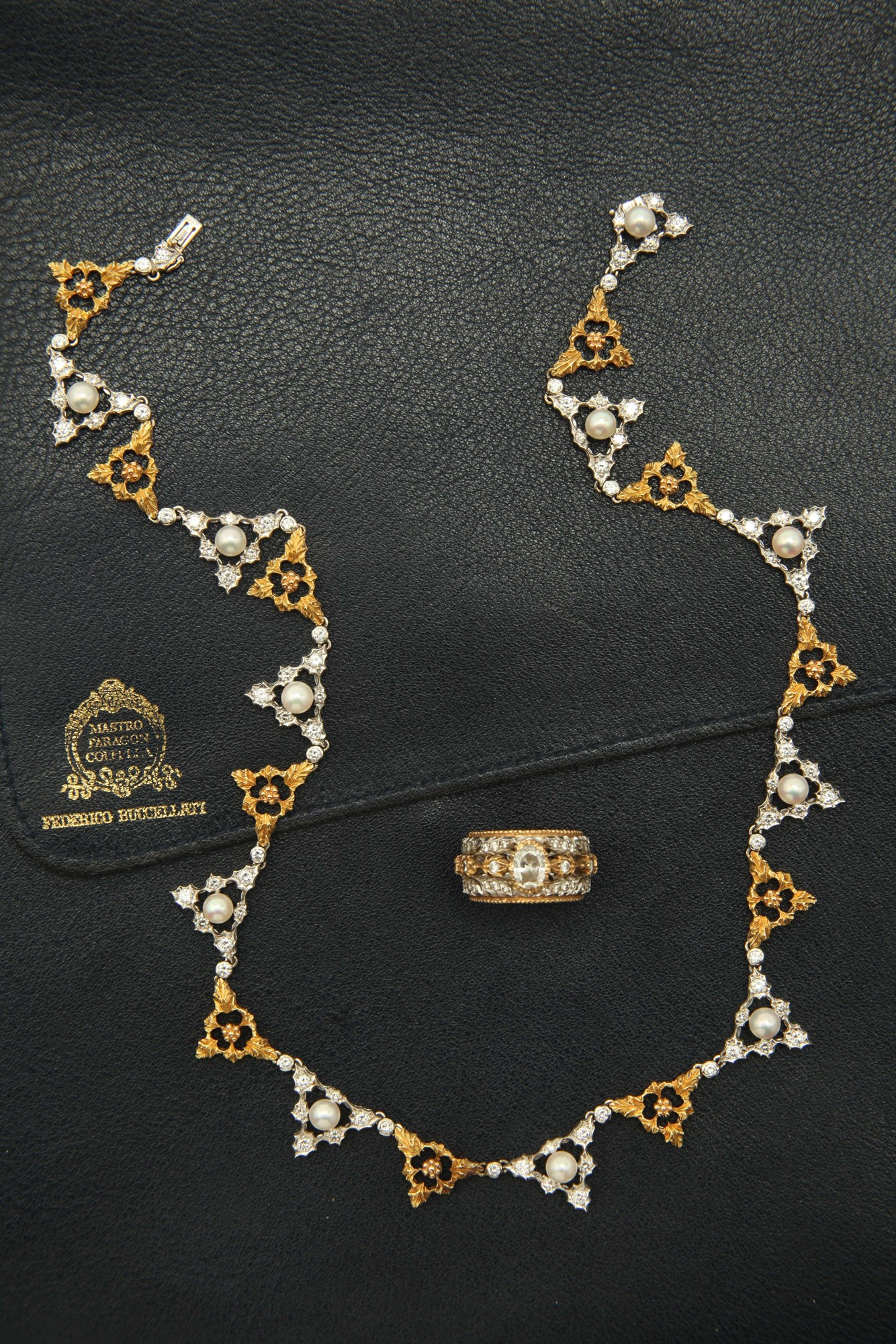Buccellati. A diamond, pearl and gold necklace and ring