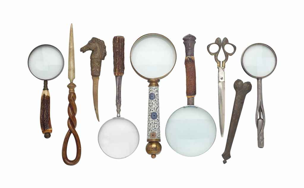 A GROUP OF FIVE MAGNIFYING GLASSES, TWO LETTER OPENERS AND A PAIR OF SCISSORS,