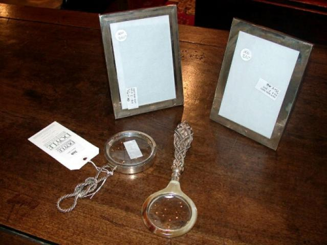 Two Silver Magnifying Glasses Together with Two Silver Frames