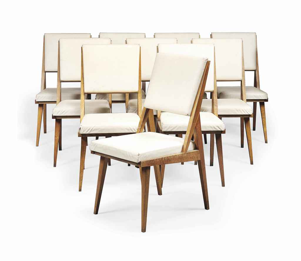 A SET OF TEN ITALIAN WALNUT CHAIRS IN THE STYLE OF GIO PONTI