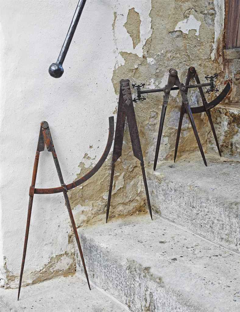 A COLLECTION OF FOUR WROUGHT IRON PAIRS OF COMPASSES