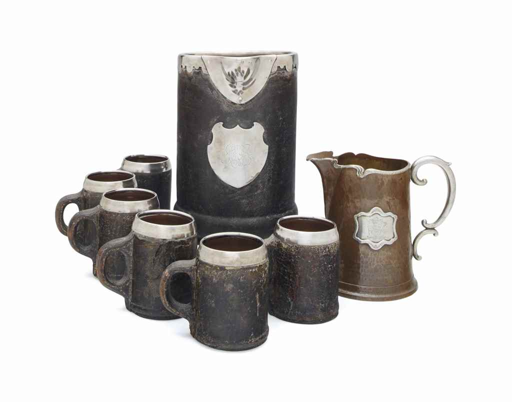 AN AMERICAN SILVER AND COPPER PRESENTATION WATER PITCHER, AND A SET OF SIX AMERICAN SILVER-MOUNTED LEATHER AND COPPER BEER STEINS AND LARGE BEER JUG