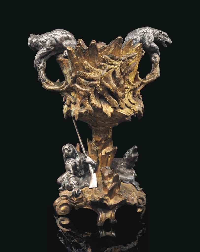 A CONTINENTAL ORMOLU AND SILVERED-BRONZE FIGURAL BOTTLE COOLER