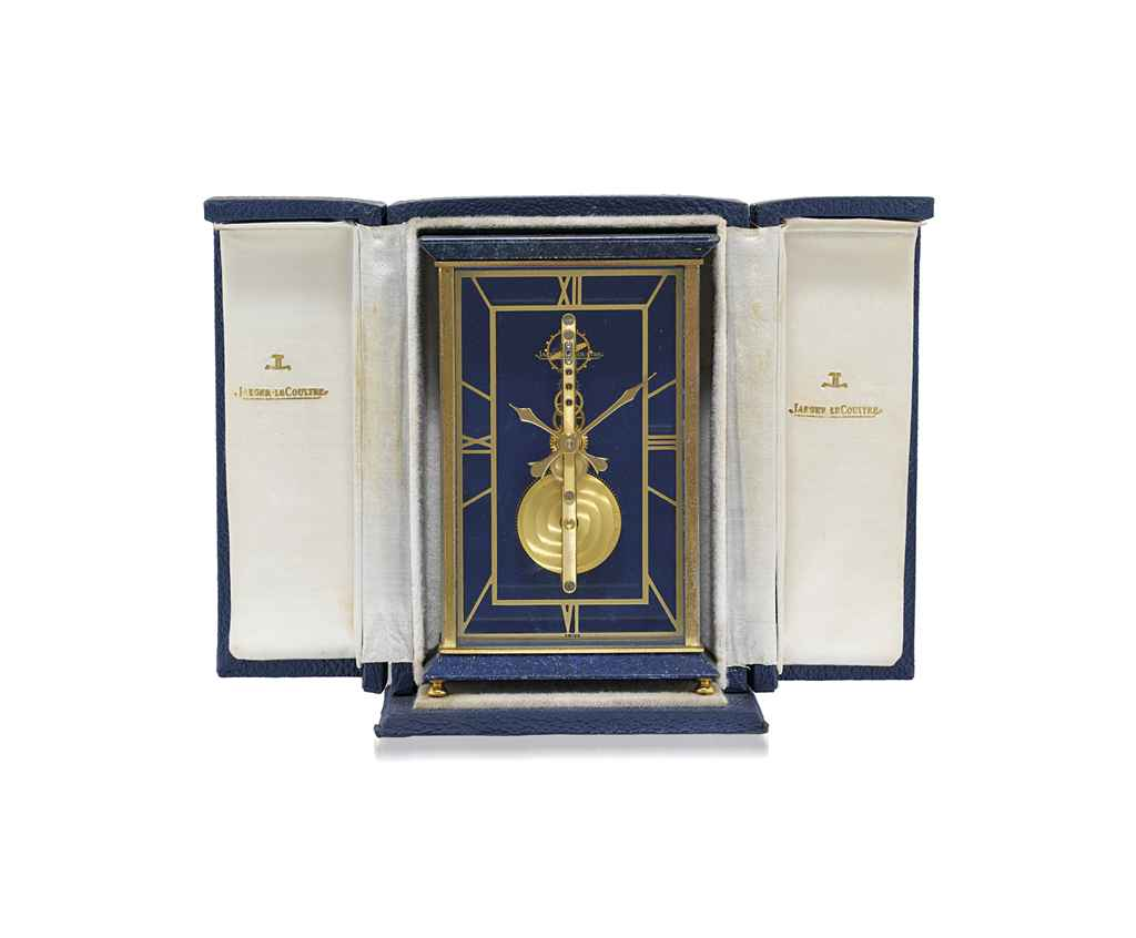 JAEGER-LECOULTRE, A BRASS EIGHT DAY DESK CLOCK WITH VISIBLE MOVEMENT AND ORIGINAL FITTED BOX