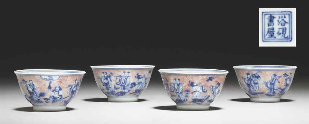 A SET OF FOUR BLUE AND WHITE AND COPPER RED-DECORATED WINE CUPS