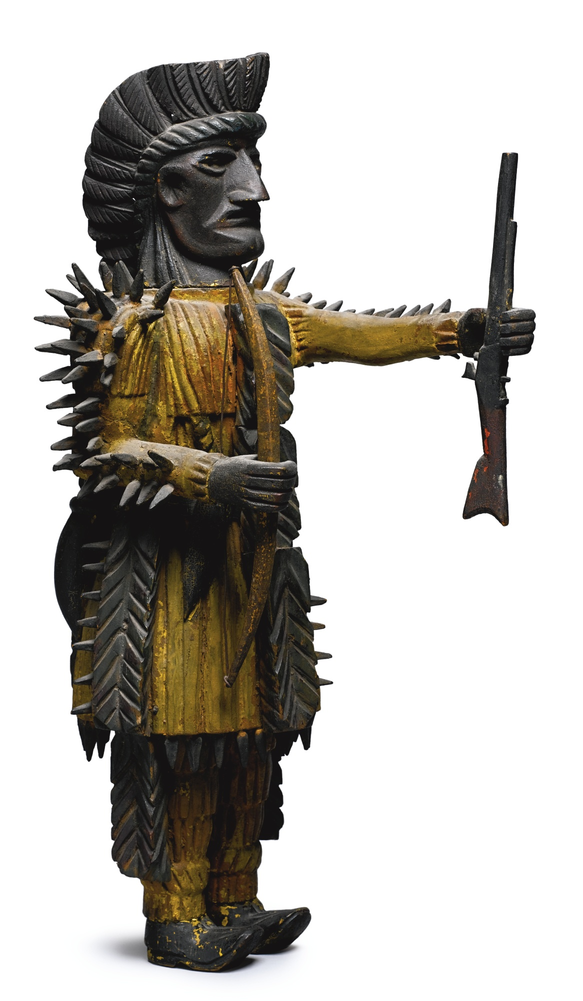 RARE CARVED AND PAINTED PINE INDIAN CHIEF WITH RIFLE, HATCHET, BOW AND QUIVER OF ARROWS, American, Late 19th/Early 20th Century