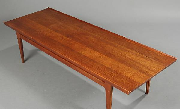 Finn Juhl: Solid teak coffee table with raised edges. Model FD 531/45. Manufactured by France & Son. H. 45. L. 175. W. 60 cm.