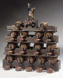 A DUTCH POLYCHROME DECORATED WOODEN MODEL OF A RACK WITH LIQUOR AND JENEVER BARRELS 'DRANKORGEL'