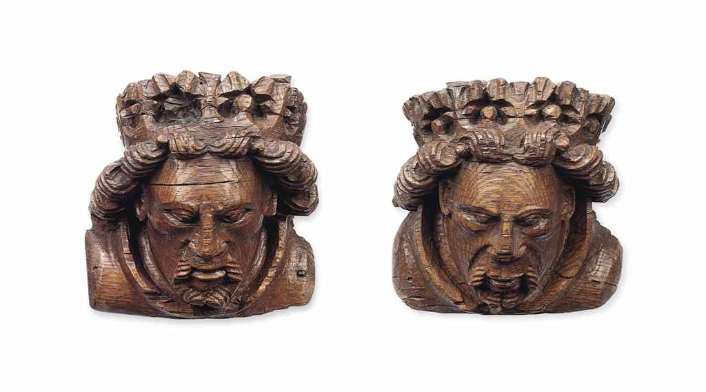 A PAIR OF ENGLISH MEDIEVAL OAK CROWNED HEAD CORBELS