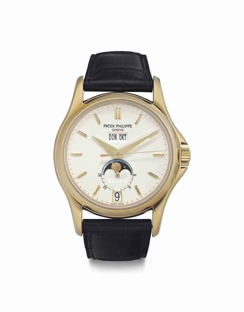 Patek Philippe. A Rare and Fine 18k Gold Limited Edition Automatic Annual Calendar Wristwatch with Center Seconds and Moon Phases