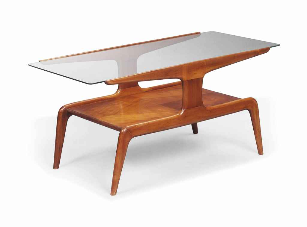 A GIO PONTI (1891 - 1979) WALNUT AND GLASS OCCASIONAL TABLE