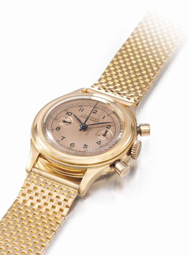Longines. A very attractive and very rare 18K pink gold flyback chronograph wristwatch with pink dial, pulsometer and bracelet