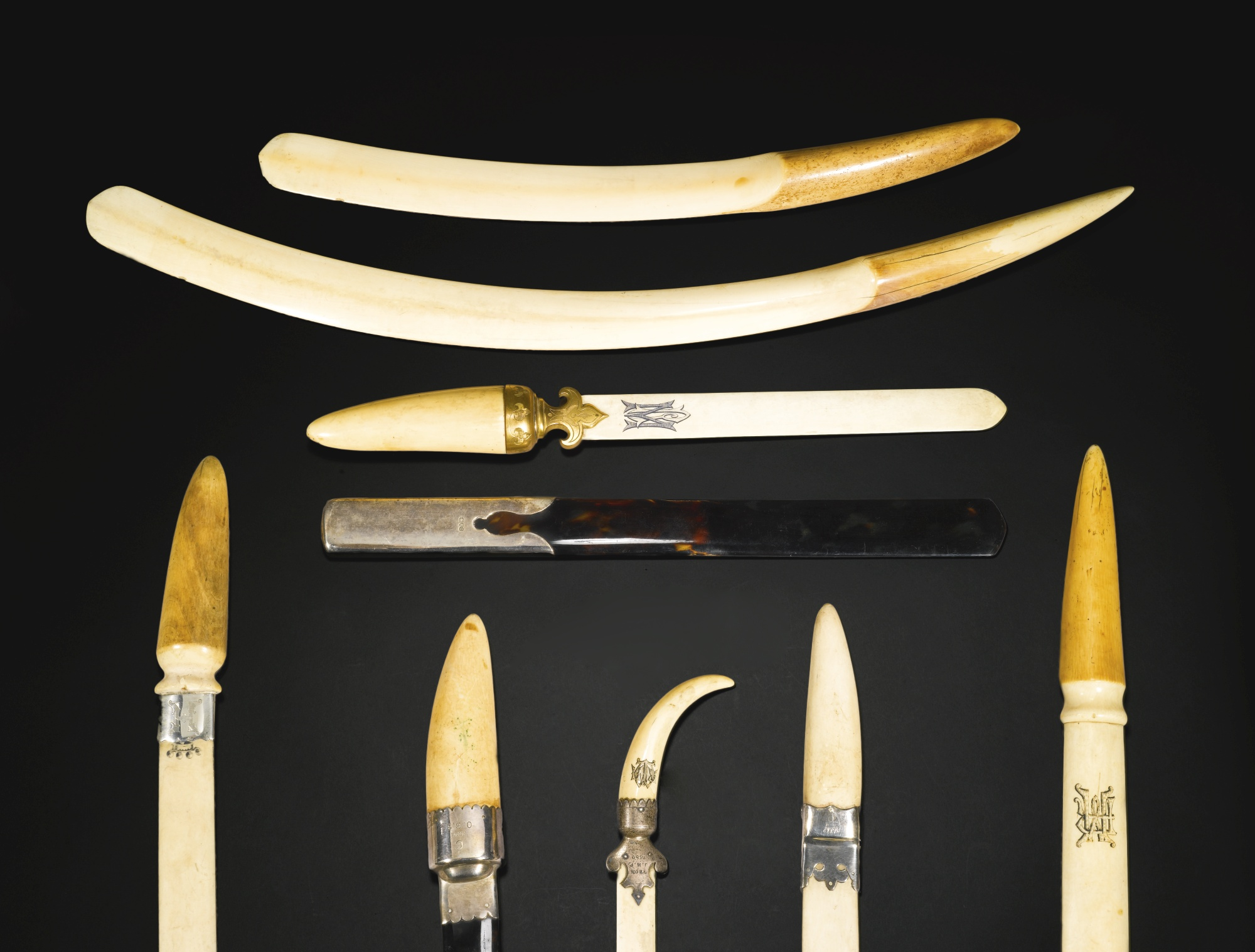 Nine ivory letter/newspaper openers with gilt-metal and / or silver mounts, late 19th / early 20th century