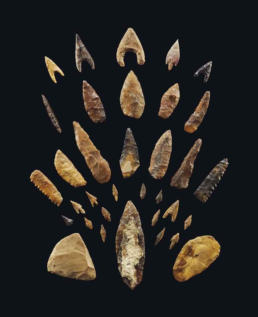THIRTY-FOUR EGYPTIAN FLINT TOOLS AND ARROWHEADS