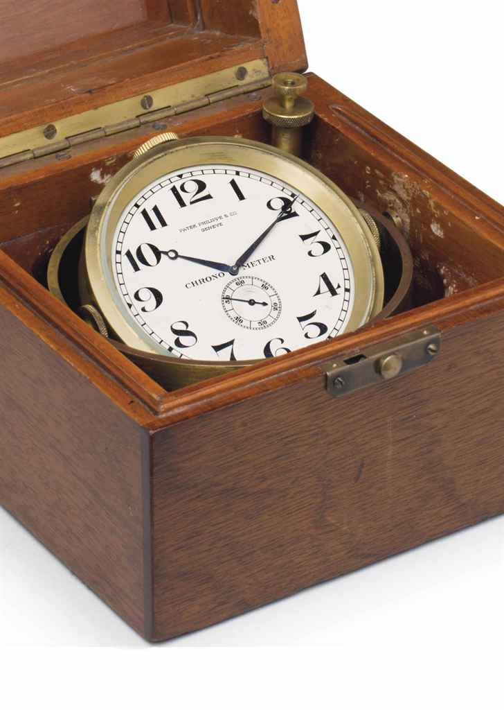 Patek Philippe. A Fine Gilt Brass Special Keyless Lever Chronometer with Wooden Presentation Box