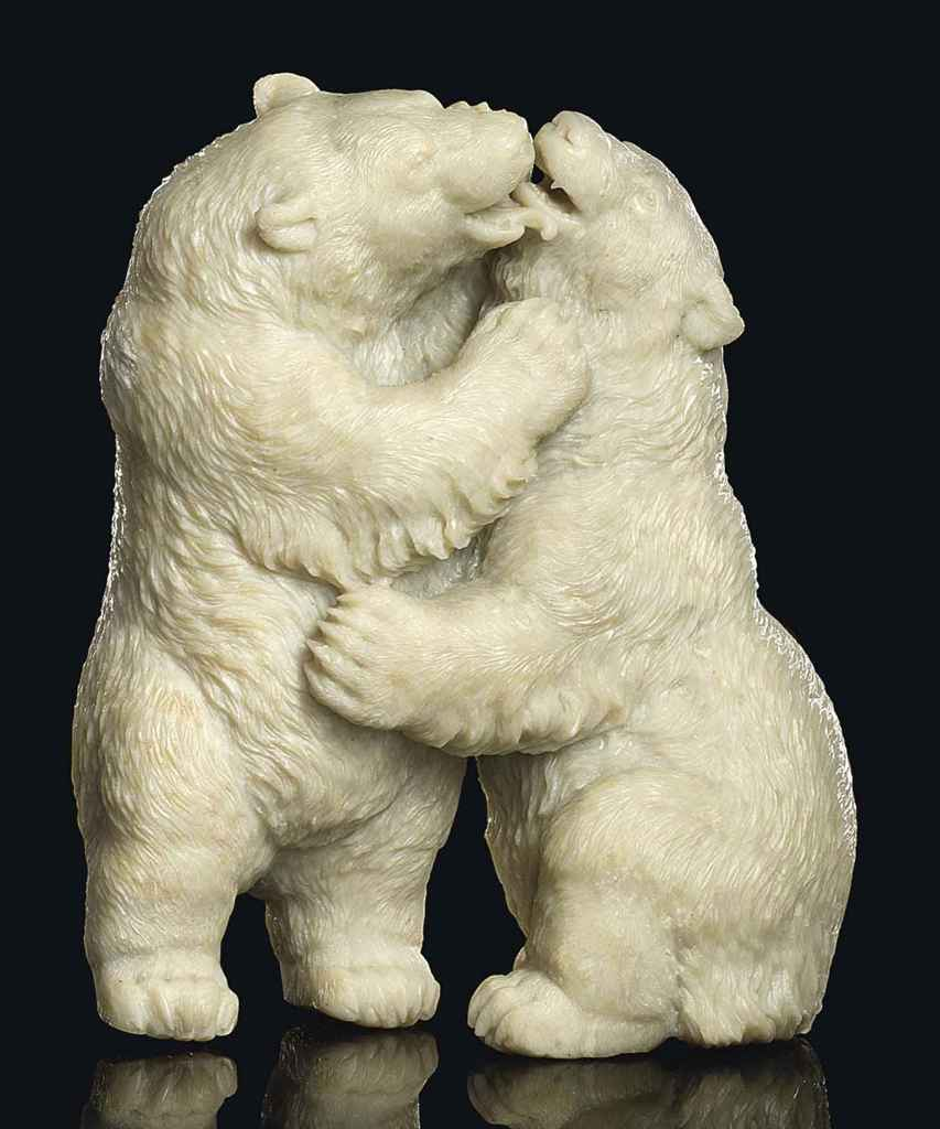 A CARVED ALABASTER MODEL OF TWO POLAR BEARS