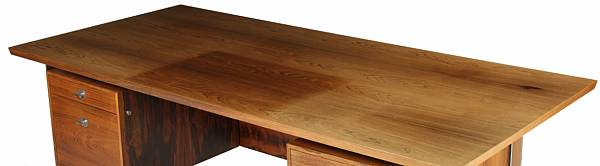 """Finn Juhl: """"Technocrat"""". A free-standing Brazilian rosewood desk, front with two drawer sections. H. 72. L. 215. W. 100 cm."""