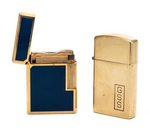 A Zippo 14-Karat Gold Lighter Height 2 1/8 inches.